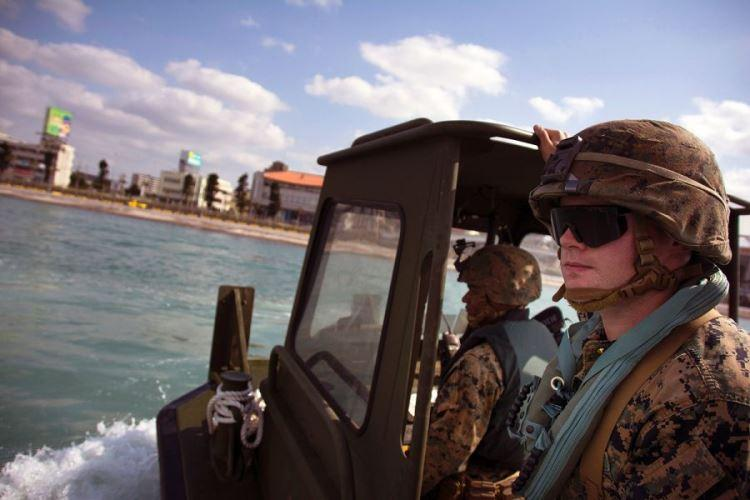 First Lt. Daniel Asheim watches Marines perform maneuvers using a bridge-erection boat during licensing operations at Naha, Okinawa, Tuesday, Jan. 29, 2019. (CARLOS VAZQUEZ/STARS AND STRIPES)