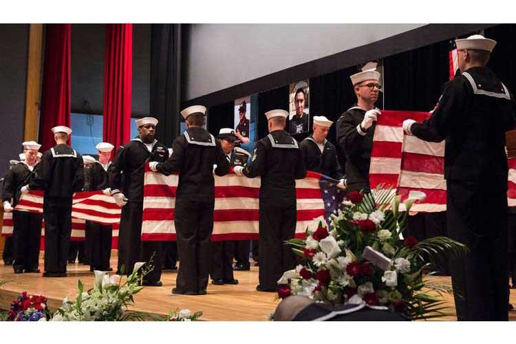 Sailors ceremonially fold seven American flags during a June 27, 2017 memorial ceremony at Fleet Activities Yokosuka, Japan, for seven sailors assigned to USS Fitzgerald who were killed in a collision at sea. (RAYMOND D. DIAZ III/U.S. NAVY)