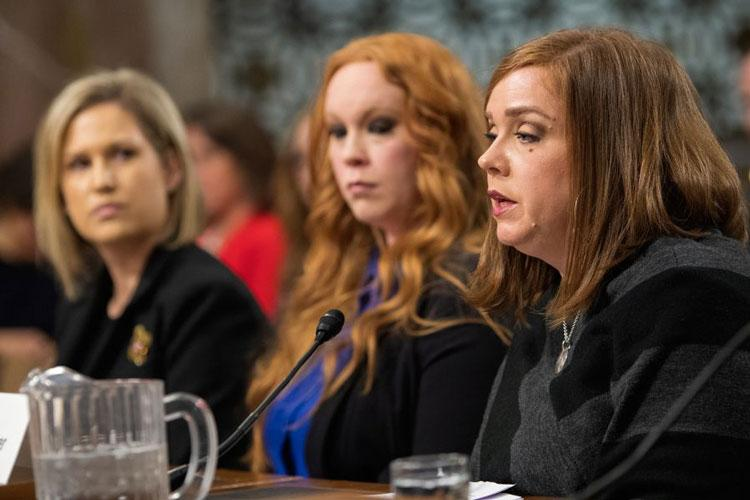 Military spouse Janna Driver testifies Wednesday, Feb. 13, 2019, during a Senate Armed Services subcommittee hearing on Capitol Hill in Washington, as fellow military spouses Crystal Cornwall, left, and Jana Wanner look on. (CARLOS BONGIOANNI/STARS AND STRIPES)