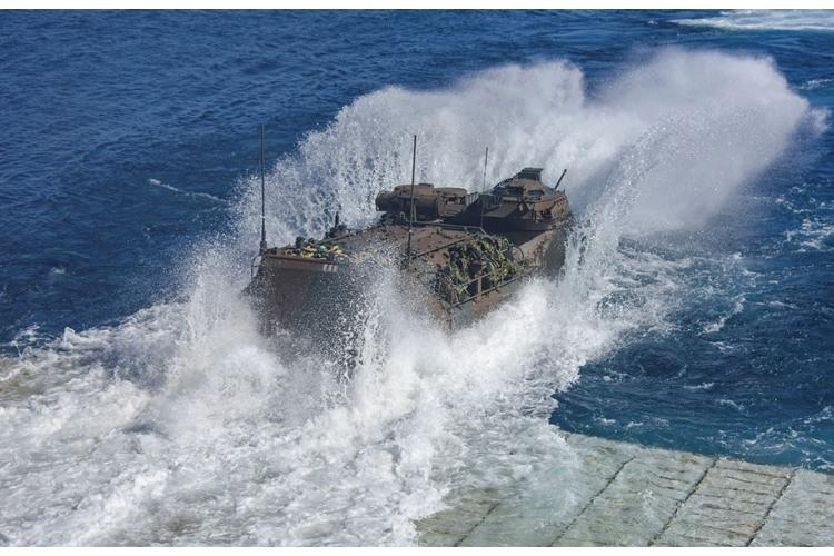 PACIFIC OCEAN (Feb. 12, 2020) Soldiers from Japan Ground Self-Defense Force Amphibious Rapid Deployment Regiment launch an amphibious assault vehicle from the well deck of the Harpers Ferry-class amphibious dock landing ship USS Pearl Harbor (LSD 52) for an amphibious assault demonstration as part of Iron Fist 2020, Feb. 12, 2020. (U.S. Navy photo by Mass Communication Specialist 2nd Class Natalie M. Byers/Released)