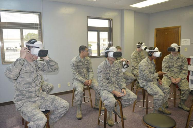 Airmen assigned to the 18th Maintenance Group use virtual reality headsets to review maintenance tasks March 28, 2019, at Kadena Air Base, Japan. The 18th MXG is currently developing and reinforcing job tasks for maintainers across three separate aircraft.(U.S. Air Force photo by Staff Sgt. Benjamin Sutton)