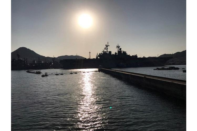 Ships, including the USS Wasp, are seen in silhouette at Sasebo Naval Base, Japan, in March 2019. (AARON KIDD/STARS AND STRIPES)