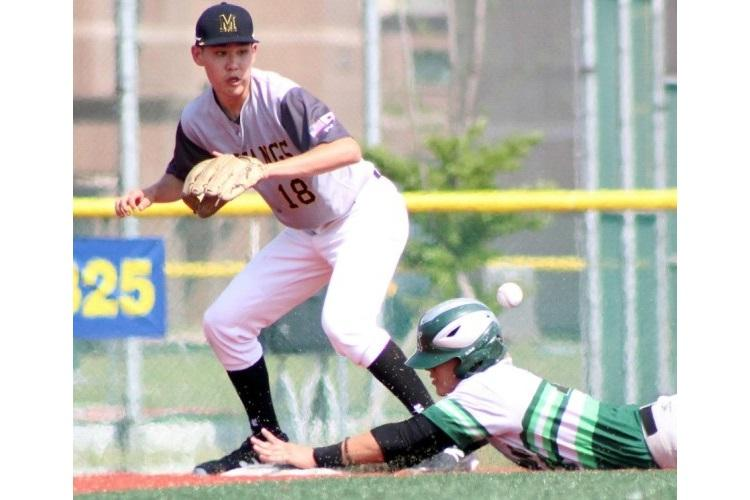The throw comes in too low and late to ASIJ infielder Ken Hemmer to tag out a Kubasaki baserunner. (KATHLEEN PACLIPAN/SPECIAL TO STRIPES)