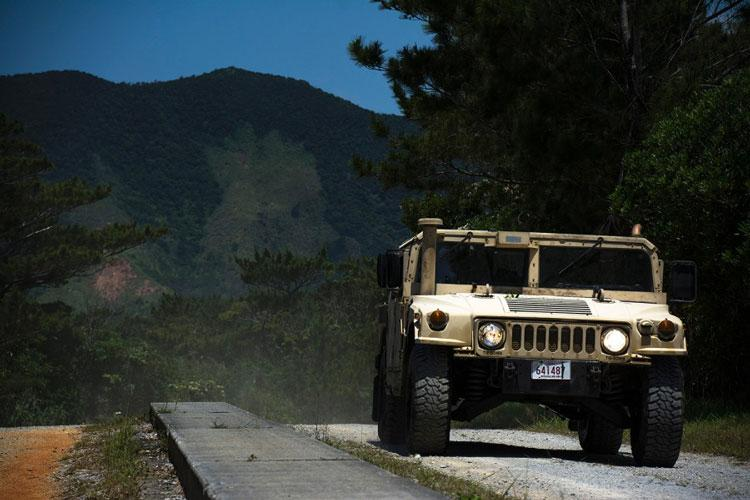 Marines take a Humvee through the Advanced Motor Vehicle Operations Course at Camp Schwab, Okinawa, May 23, 2019. (CARLOS VAZQUEZ/STARS AND STRIPES)