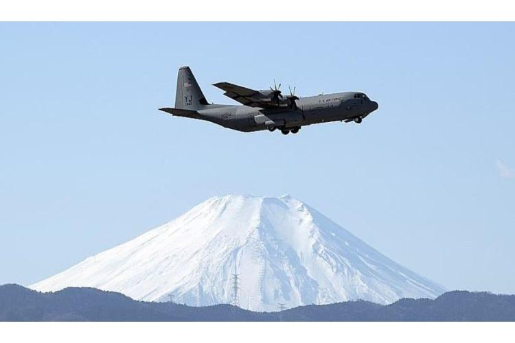 A C-130J Super Hercules assigned to the 36th Airlift Squadron flies over Yokota Air Base, Japan, with Mount Fuji in the background, Jan. 8, 2019. (YASUO OSAKABE/U.S. AIR FORCE)