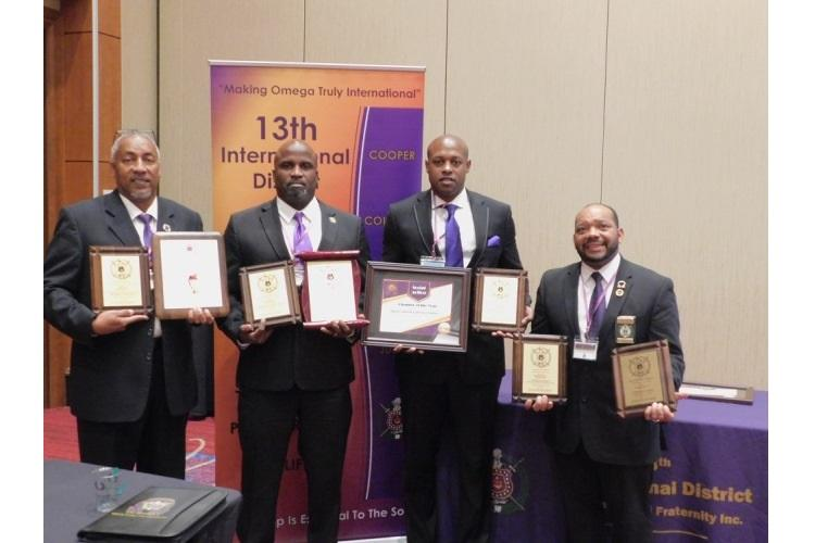 Brothers of Sigma Gamma Gamma Graduate Chapter displaying all awards received at the 26th Annual 13th International District Meeting in Atlantic City, New Jersey: Sigma Gamma Gamma Graduate Chapter Adviser John Smith, SGG Basileus Cortez Pree, Eugene Porter and Michael Robinson