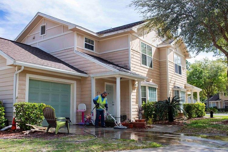 MAYPORT, Fla. (March 18, 2019) A maintenance worker for Balfour Beatty Housing power washes the driveway of a home at Marsh Cove, a military residential community at Naval Station Mayport. (U.S. Navy photo by Mass Communication Specialist 3rd Nathan T. Beard)