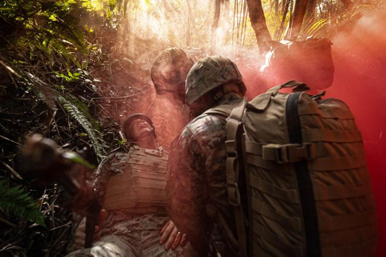 CAMP GONSALVES, Okinawa, Japan (June 7, 2019) Hospital Corpsmen respond to a simulated patient casualty during a tactical combat casualty care exercise as part of a rigorous Jungle Medicine Course at Jungle Warfare Training Center, Okinawa, Japan. The 10-day medical course trains Navy medical personnel assigned to Marine forces on jungle survival skills, patient tracking, field medical care, and casualty evacuation techniques. (U.S. Navy photo by Mass Communication Specialist 2nd Class Jeanette Mullinax)