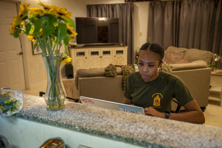 U.S. Marine Corps Sgt. Jerre'al Hayles, a Pacific trial team paralegal with the Legal Service Support Section, studies at home on Camp Foster, Okinawa, Japan, March 10, 2021. Hayles won the 2020 Trial Service Office Marine of the Year award for going above and beyond the expectations and duties within the unit. Hayles is a native of Smithfield, Virginia. (U.S. Marine Corps photo by Cpl. Karis Mattingly)
