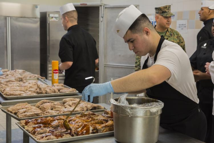 Marines prepare food for the Headquarters Marie Corps Inspection at Camp Foster, Okinawa, Japan, Feb. 25, 2020. The inspection was to insure Marines are being taken care of, and the best performing mess hall receives the title of USMC Chow Hall of the Year and receive the Major General W.P.T. Hill Award. (U.S. Marine Corps photo by Lance Cpl. Zachary Larsen)