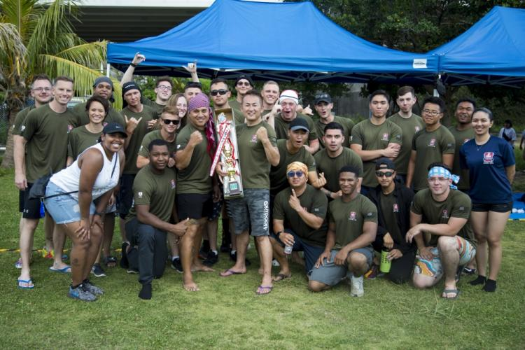 "The Single Marine Program dragon boat team poses with their trophy during the 45th Annual Naha Dragon Boat Race May 5, 2019 at Naha Port, Okinawa, Japan. Local and military communities participated in the famous race, also known as the ""Haarii."" The SMP team won first place in the preliminary heat. (U.S. Marine Corps photo by Lance Cpl. Nicole Rogge)"