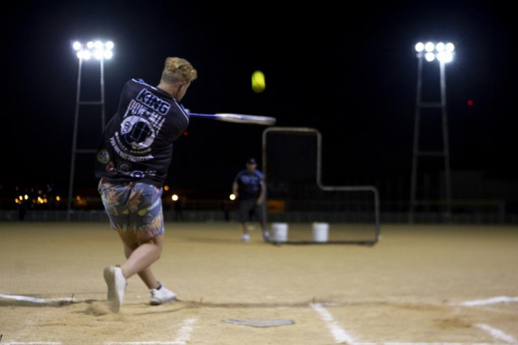 U.S. Airforce Senior Airman Derek King, with 51st Maintenance Squadron, hits a homerun on Camp Foster, Okinawa, Japan, July 3, 2019. King's efforts were in partition to the Pacific-Wide Firecracker Softball Skills Challenge; a trial to test a player's skills on how well a player can perform in a specific element of the sport. (U.S Marine Corps Photo by Cpl. Christopher Madero)