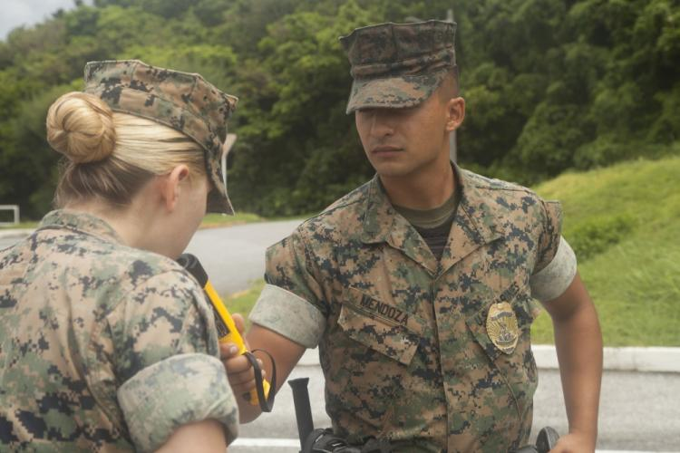 U.S. Marine Corps Lance Cpl. Samuel Mendoza, a military policeman with Marine Corps Installations Pacific-Marine Corps Base (MCIPAC-MCB) Camp Smedley D. Butler Provost Marshal's Office (PMO), conducts a simulated sobriety check at Camp Foster, Okinawa, Japan, Aug. 7, 2019. MCIPAC-MCB PMO began implementing random field sobriety checks in accordance with Marine Corps Base Butler Bulletin 5560. (U.S. Marine Corps photo by Pfc. Colton K. Garrett)