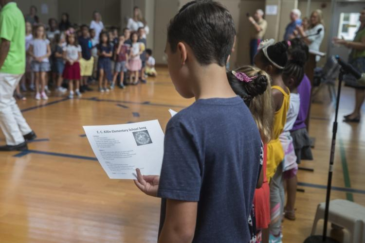 An elementary school student recites the school song during an opening ceremony at Edward C. Killin Elementary School, Camp Foster, Okinawa, Japan, Aug. 26, 2019. The ceremony was held to welcome students and faculty back after a ten-week-long summer break. (U.S. Marine Corps photo by Lance Cpl. Krysten I. Houk)