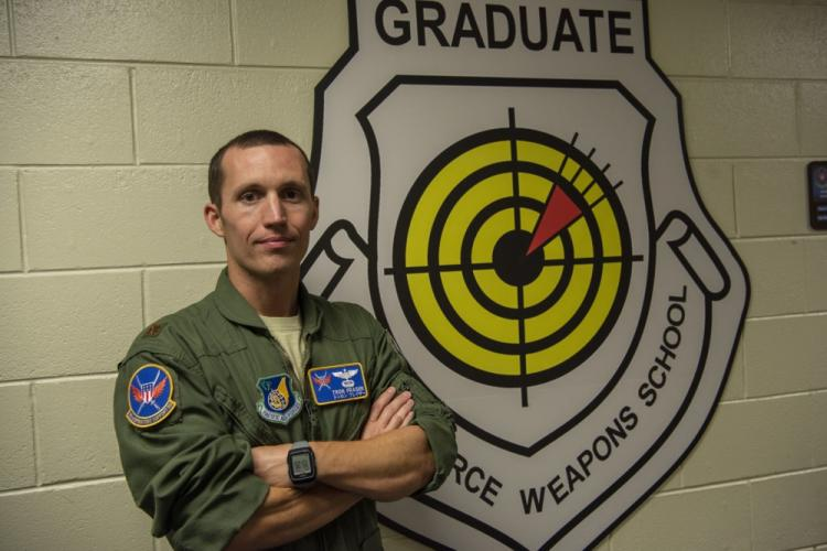 U.S. Air Force Maj. Mark Fraser, 18th Operations Support Squadron chief of wing weapons and tactics, was recently recognized for his outstanding performance at Kadena Air Base, Japan, by receiving the 2019 Air Rescue Association Richard T. Kight Award. Fraser distinguished himself through superior innovation and team management. (U.S. Air Force photo by Senior Airman Rhett Isbell)