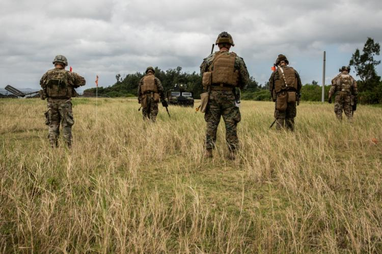 U.S. service members sweep for land mines during an explosive ordnance disposal exercise at Kin Blue Training Area, Okinawa, Japan, Sept. 19, 2019. The EOD exercise was designed to simulate conventional warfare and the use of conventional ordnance and involved the participation of three U.S. military branches and over 43 different military occupational specialties within III Marine Expeditionary Force. (U.S. Marine Corps photo by Lance Cpl. Carla Elizabeth O)