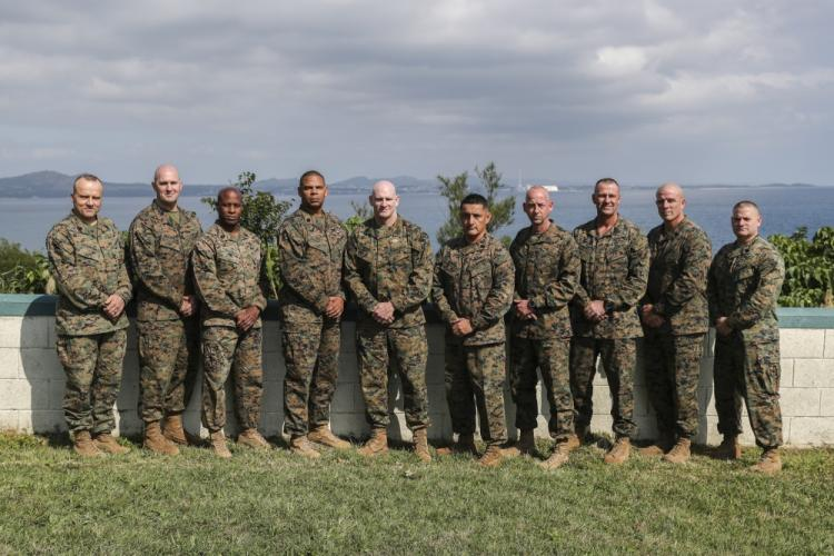Sgt. Maj. Troy E. Black, center, the 19th Sergeant Major of the Marine Corps, stands for a photo with fellow sergeants major during the Force Level Summit 2020 held in Okinawa, Japan, Jan. 15, 2020. The summit is a yearly event held to bring Force Level Sergeants Major together with the Sergeant Major of the Marine Corps to discuss ideas, lessons learned and address current and future concerns of the Marine Corps in order to improve lethality and readiness. (Photo by Lance Cpl. Hannah Hall)
