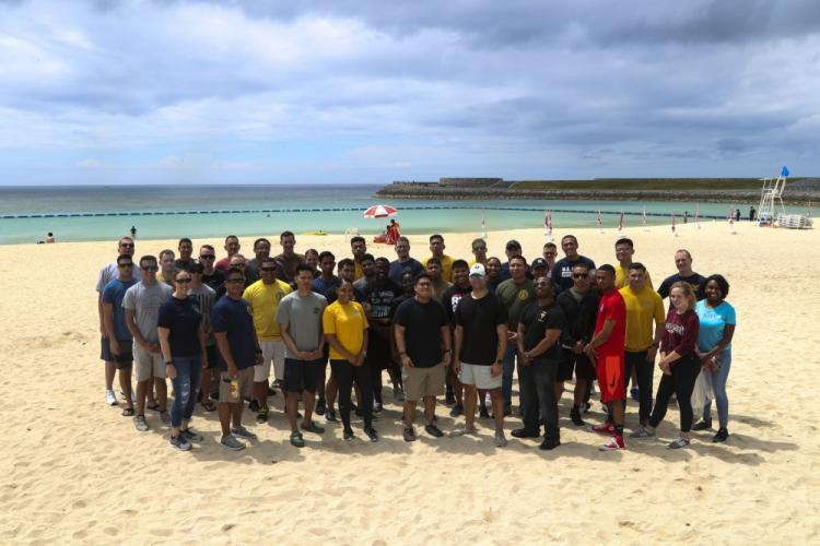U.S. service members with Marine Corps Installations Pacific and III Marine Expeditionary Force pose for a group photo after cleaning Tropical Beach, Okinawa Japan, May 31, 2019. The beach cleanup was hosted by 3d Dental Battalion, 3d Marine Logistics Group in order to promote unit camaraderie. (U.S. Marine Corps photo by Lance Cpl. Savannah Mesimer)