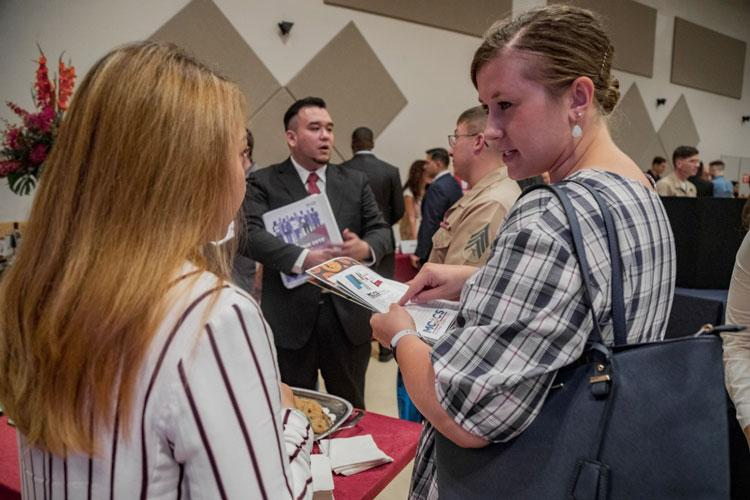 Members of the U.S. military community interact with over 30 different employers during the annual Okinawa Career Fair, Oct. 4, 2019, on Camp Foster, Okinawa, Japan. The career fair allows active and retired service members and families to receive guidance for professional development, finding connections with different companies and becoming a staff member or volunteer. (U.S. Marine Corps photo by Lance Cpl. Karis Mattingly)