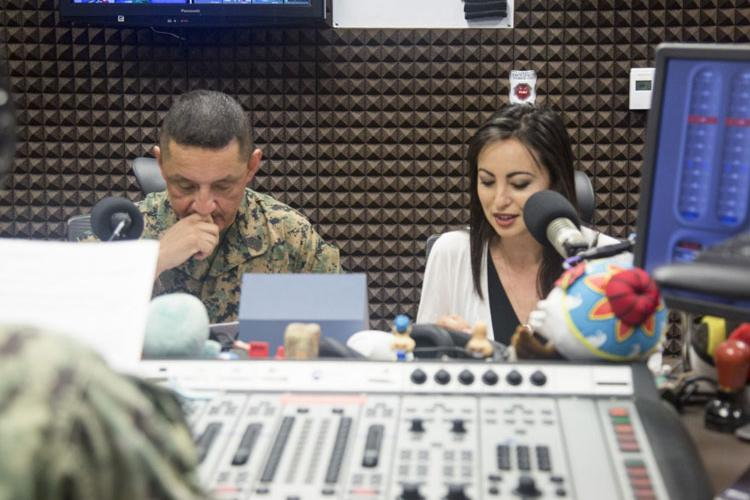 U.S. Marine Corps Sgt. Maj. Mario Marquez, the III Marine Expeditionary Force sergeant major, left, and Mari Gregory speaks on their radio show with AFN May 14, 2019, on Plaza Housing. Gregory and Marquez have partnered up since July 2017 to provide time and space for the shared Okinawan community to understand each other and exchange friendship. (Photo by Nika Nashiro)
