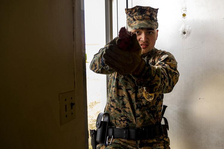 U.S. Marines Corps Lance Cpl. William Anderson with Headquarters and Support Battalion, Provost Marshal Office (PMO), Operations, participates in an active shooter, training Camp Foster, Okinawa, Japan, Nov. 26, 2019. Marines with PMO conducted the training to ensure readiness and reliability in the event of an active shooter. (U.S. Marine Corps photo by Lance Cpl. Karis Mattingly)