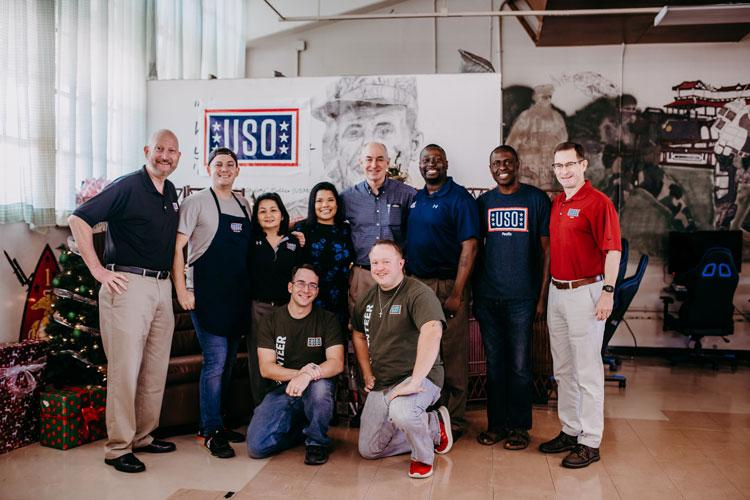 Staff and Volunteers with Dr. J.D. Crouch at USO Schwab