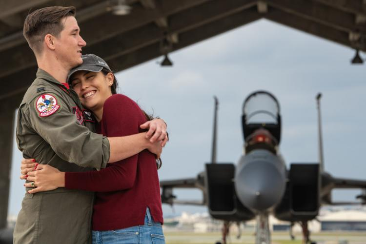 U.S. Air Force Capt. Cole Holloway a pilot from the 67th Fighter Squadron, hugs his wife, Meghan Holloway, Dec. 14, 2018, on Kadena Air Base, Japan. After processing his diagnosis of amyotrophic lateral sclerosis (ALS), Holloway's focus is on being a good husband, family member and friend. (U.S. Air Force photo by Staff Sgt. Micaiah Anthony)