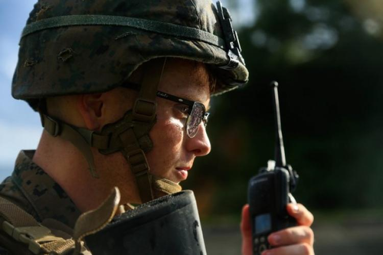 U.S. Marine Corps Cpl. William Testorff with Headquarters Battalion, 3rd Marine Division, performs a radio check while on patrol during Samurai 20-1 on Camp Hansen, Okinawa, Japan, Oct. 22, 2019. The purpose of this exercise is to conduct battle drills that validate the 3rd Marine Division's movement, setup of a combat operations center, force protection, and passage of command and control between supporting elements. (U.S. Marine Corps photo by Sgt. David Staten)