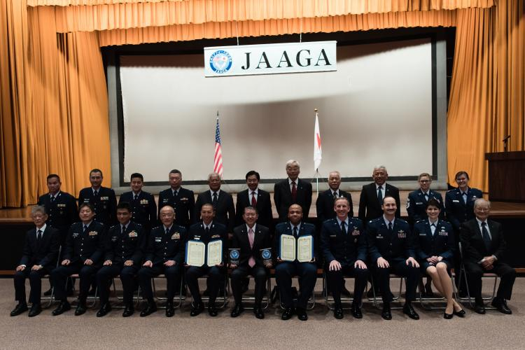 Airmen from the Japan Air Self-Defense Force's Naha Air Base and U.S. Air Force's 18th Wing pose for group photo with Japan-America Air Force Goodwill Association members after the 2018 JAAGA Awards Ceremony at Naha Air Base, Japan. Leadership from Naha Air Base and the 18th Wing came together to recognize the accomplishments of their Japan-America Air Force Goodwill Association awardees and the importance of partnership during the 2018 JAAGA Awards Ceremony. (Photo by Staff Sgt. Omari Bernard)