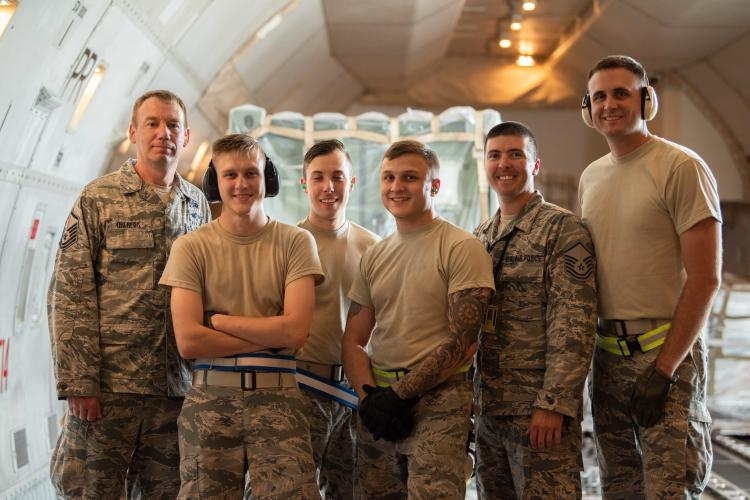 U.S. Air Force Airmen assigned to the 139th Logistics Readiness Squadron pose for a photo on a Boeing 747 during annual field training June 11, 2019, at Kadena Air Base, Japan. As an Air National Gaurd unit, the 139th LRS maintains a capable, ready force to support aerial port operations for both Federal and state mission sets. (U.S. Air Force photo by Senior Airman Kristan Campbell)