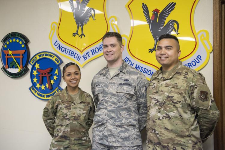 From left, Master Sgt. Joy McCammon, 718th Force Support Squadron casualty operations section chief, Staff Sgt. Alexander Nestle, 18th Communications Squadron software development supervisor, and Tech. Sgt. Christopher Sills, 18th CS NCO in charge of application development, stand for a photo at Kadena Air Base, Japan, Nov. 19, 2019. They are part of the PRAS team named as one of two U.S. Pacific Air Forces Spark Tank nominees to compete at the Air Force level. (Photo by Airman 1st Class Mandy Foster)