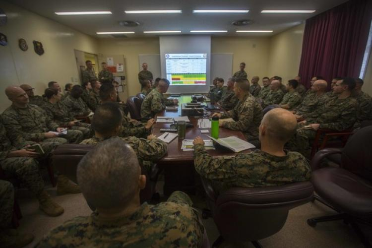 Col. Robert Brodie, commanding officer of the 31st Marine Expeditionary Unit, and Sgt. Maj. Edwin Mota, 31st MEU sergeant major, listen in on a confirmation brief during MEU Exercise at Camp Hansen, Okinawa, Japan, Dec. 12, 2018. The 31st MEU, the Marine Corps' only continuously forward-deployed MEU, provides a flexible force ready to perform a wide range of military operations as the premier crisis response force in the Indo-Pacific Region. (U.S. Marine Crops photo by Lance Cpl. Cameron Parks)