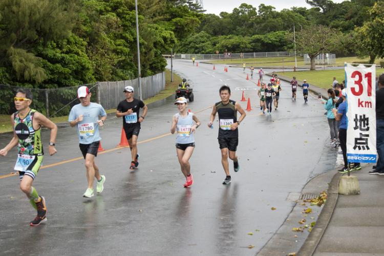 Runners participate in the Okinawa Marathon Feb. 16, 2020, at Kadena Air Base, Japan. Kadena AB has supported the Okinawa Marathon every year since 1993. (U.S. Air Force Photo by Airman 1st Class Mandy Foster)