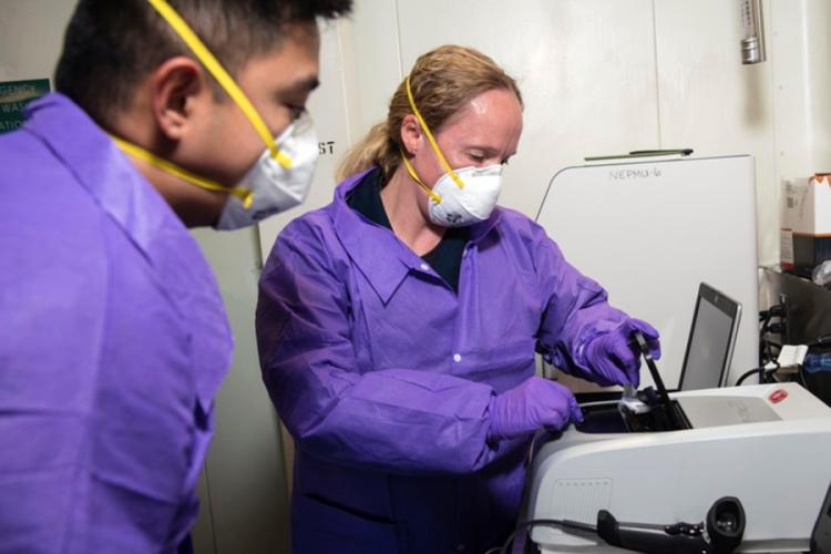 Members of a Navy preventative medicine team test samples in a BioFire Film Array, which will test for nearly 30 different diseases, aboard the USS Blue Ridge. U.S. NAVY