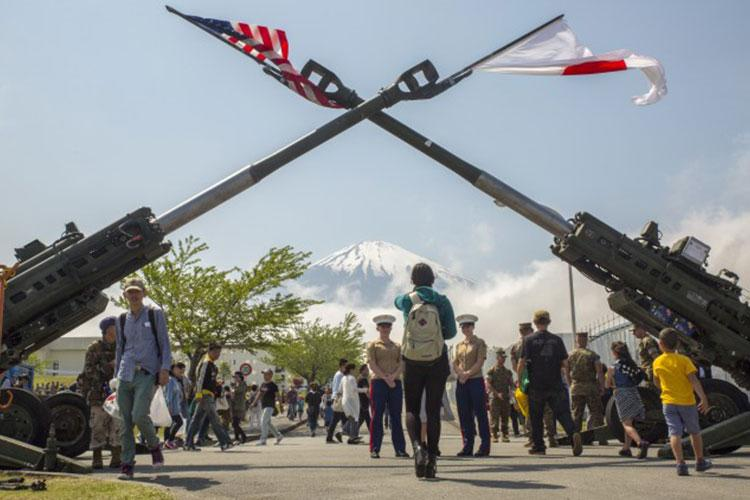 Mount Fuji watches over the Fuji Friendship Festival May 7 aboard Combined Arms Training Center Fuji, Gotemba, Japan. The festival included fun and games for all ages, such as bounce houses, face painting and live music from local artists and the U.S. 7th Fleet Band's Orient Express. The festival also had numerous displays of weapon systems along with aircraft and vehicles. Among them were Japanese tanks, a UH60 Black Hawk and the MV-22B Osprey. (Photo Credit: Cpl. Janessa Pon)