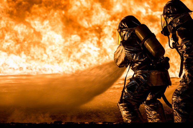 U.S. Marines with Aircraft Rescue and Firefighting use a hand line to extinguish a fuel fire Jan. 25, 2019 during live-burn training on Marine Corps Air Station Futenma, Okinawa, Japan. The training is held monthly to provide ARFF Marines with training scenarios to enhance their readiness to respond to any potential hazards or emergencies on the flight line. ARFF Marines entered the training area and used various hand lines, also known as a fire hose, to control and extinguish the fire.