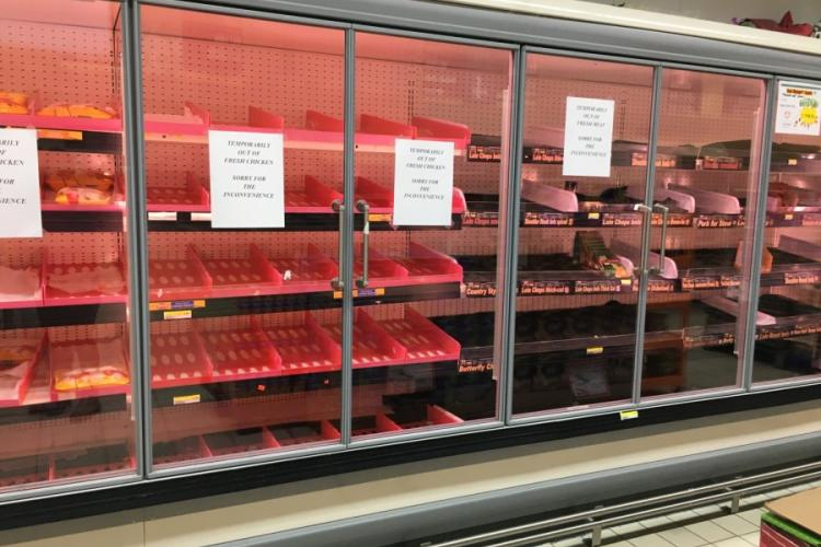Shelves at the Vogelweh commissary in Germany, sit empty of fresh chicken on Sunday, March 18, 2020. The Defense Commissary Agency has since announced ID checks at entrance and revoked policies allowing visitors to join authorized customers. STARS AND STRIPES