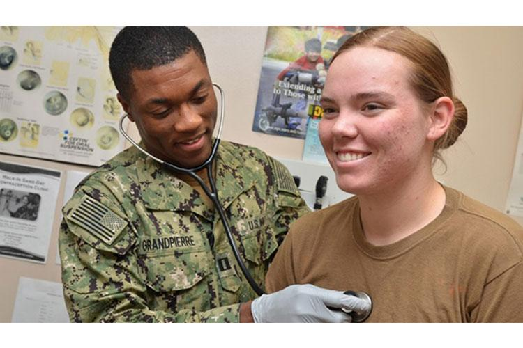 Navy Lt. Karl Yves Marie Grand Pierre, a physician assistant at Naval Branch Health Clinic Kings Bay, Georgia, checks Seaman Ashley Jackett's heart. DoD recommends that all service members and beneficiaries do just that: listen to your heart and build healthy heart habits. (U.S. Navy photo by Jacob Sippel, Naval Hospital Jacksonville)