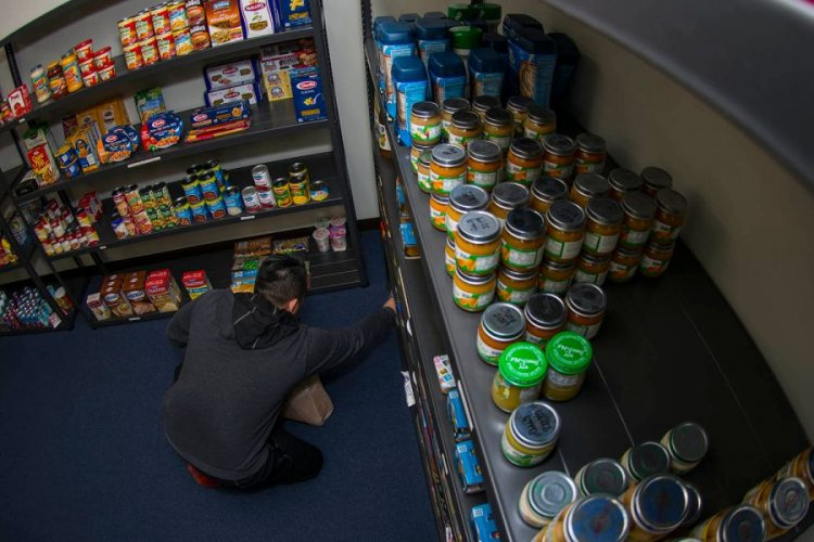 Information Systems Technician 1 Joseph Bruce takes donated items from the food pantry at Yokota Air Base, Japan, Thursday, Jan. 24, 2019.  THERON GODBOLD/STARS AND STRIPES