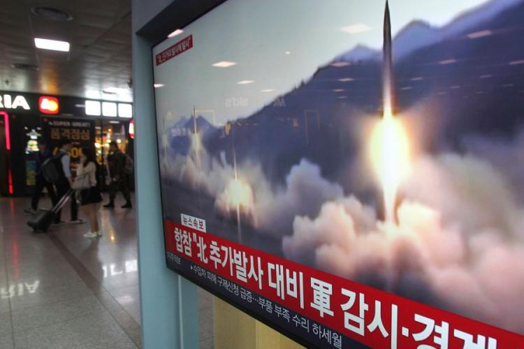 "A TV screen shows a file footage of North Korea's missile launch during a news program at the Seoul Railway Station in Seoul, South Korea, Saturday, May 4, 2019. The signs read: ""Strengthening military alertness."" AHN YOUNG-JOON/AP"