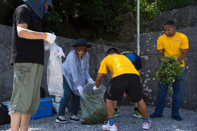U.S. and Japanese servicemembers clean up Okinawa Peace Memorial Park in Itoman, Okinawa, Saturday, June 15, 2019. CARLOS VAZQUEZ/STARS AND STRIPES