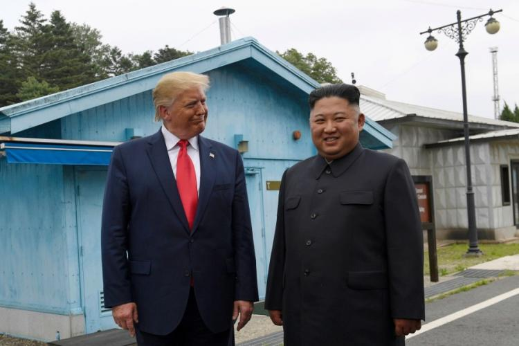 President Donald Trump, left, meets with North Korean leader Kim Jong Un at the border village of Panmunjom in Demilitarized Zone, South Korea, Sunday, June 30, 2019. SUSAN WALSH/AP