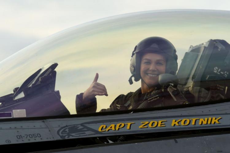 "U.S. Air Force Capt. Zoe ""SiS"" Kotnik, F-16 Viper Demonstration Team commander and pilot, smiles after a certification flight at Joint Base Langley-Eustis, Va., Jan. 29, 2019. Kotnik performed more than 30 practice missions before the certification.  KATHRYN REAVES/U.S. AIR FORCE PHOTO"