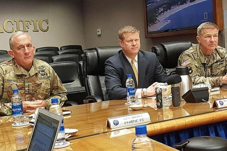 Left to right: Gen. Robert Brown, U.S. Army Pacific commander; Ryan McCarthy, Army under secretary; and Gen. James McConville, vice chief of staff of the Army, speak with reporters at Fort Shafter, Hawaii, Tuesday, March 19, 2019. WYATT OLSON/STARS AND STRIPES