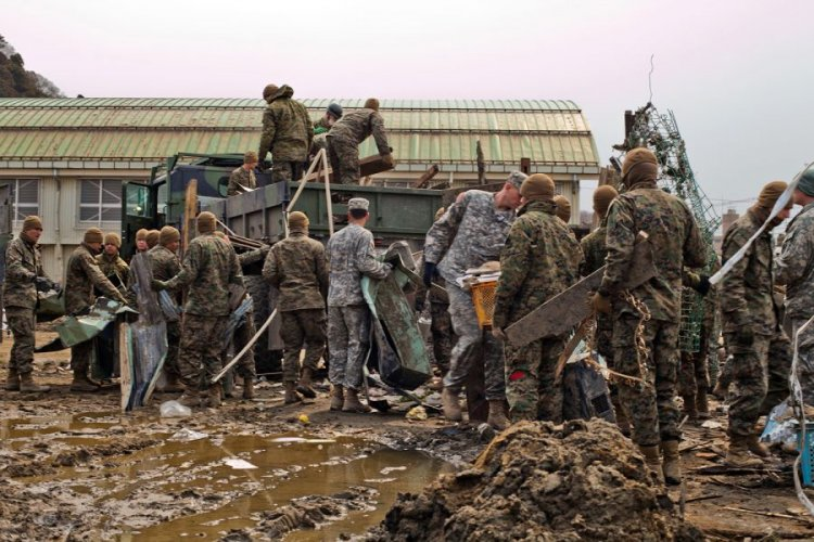 U.S. servicemembers help clean up an elementary school in Ishinomaki, Japan, April 2, 2011, after an earthquake and tsunami devastated northeastern Japan.  NATHAN BAILEY/STARS AND STRIPES