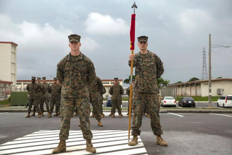 The official party of the Defense Cyberspace Operations Internal Defense Measures Company stand at parade rest during the company's activation ceremony at Camp Hansen, Okinawa, Japan, Dec. 7, 2018. ALEXIS BETANCES/U.S. MARINE CORPS