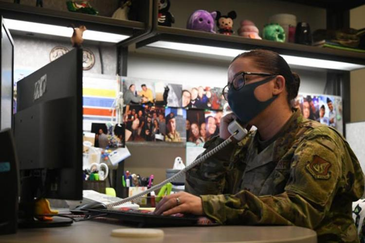 Capt. Heather Bryant, a clinical nurse with the 18th Medical Operations Squadron at Kadena Air Base, Okinawa, screens patients by phone to determine if they meet the criteria for coronavirus testing in this photo posted to the base Facebook page on May 9, 2020. U.S. AIR FORCE