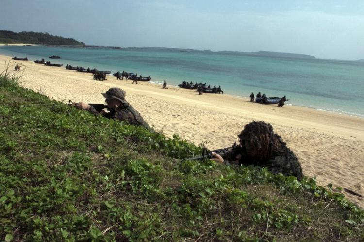 U.S. Marines come ashore with members of the Japan Ground Self-Defense Force's new amphibious brigade during an exercise in Kin, Okinawa, Sunday, Feb. 9, 2020. MATT BURKE/STARS AND STRIPES