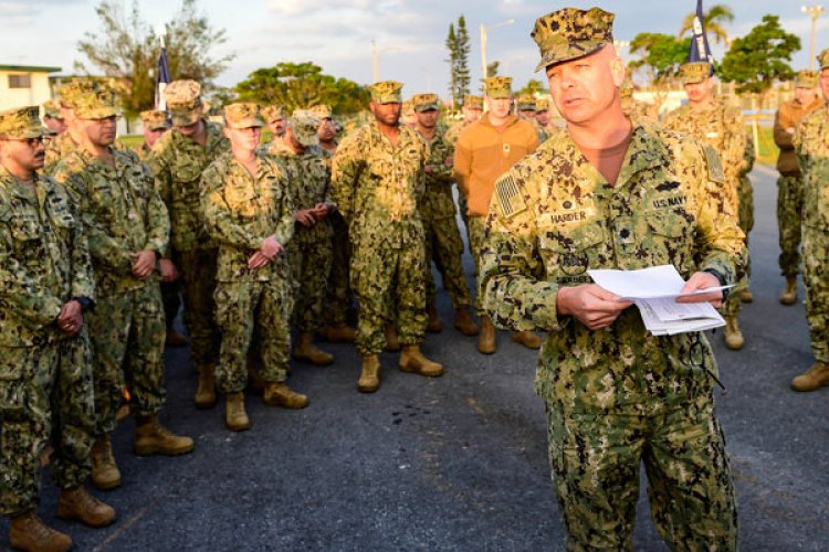 Cmdr. Joseph Harder, commanding officer of Naval Mobile Construction Battalion (NMCB) 3, announces the battalion's selection for three 2018 Navy-wide unit community service awards during command quarters onboard Camp Shields in Okinawa, Japan. (U.S. Navy photo by Mass Communication Specialist 2nd Class Michael Lopez)