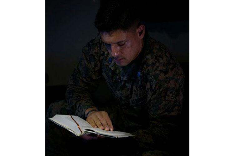 U.S. Marine Corps Sgt. Avery Luengo, the platoon sergeant for G-6 Customer Service Branch, reads his book on Camp Foster, Okinawa, Japan, Feb. 12, 2020. Luengo remains proactive with his Marines and his own duties by being a force multiplier and exceeding the standard of a noncommissioned officer by earning several awards and certifications through various demanding billets. Luengo is a native of Reynosa, Mexico, and McAllen, Texas. (U.S. Marine Corps photo by Cpl. Karis Mattingly)
